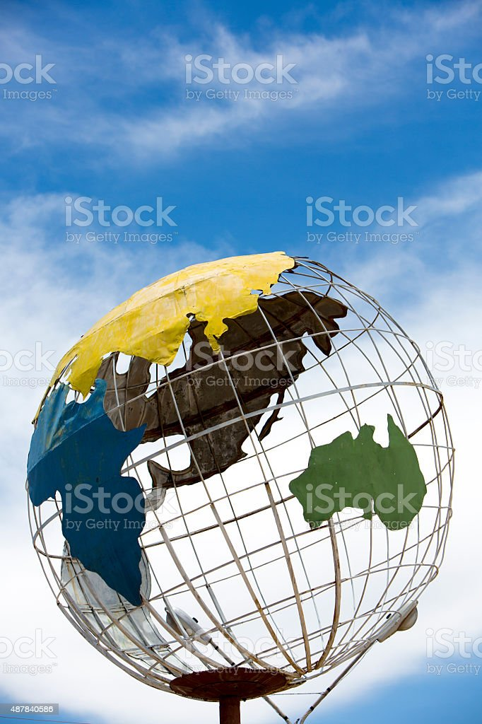 Iron earth globe structure with blue sky and Asia continent stock photo