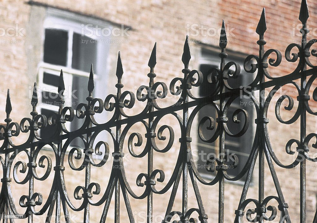 Iron fence - work of the old masters. stock photo