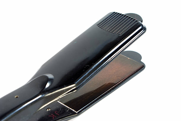 Iron for hair - straightener, isolated on the white background stock photo