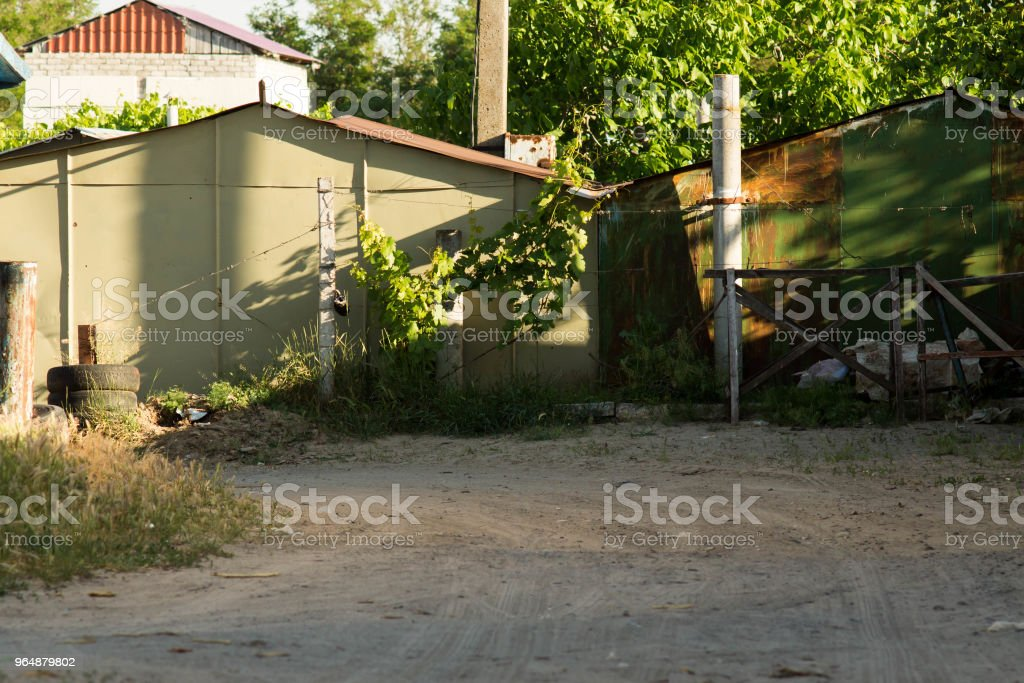 Iron garages in a garage cooperative with branches of grapes royalty-free stock photo