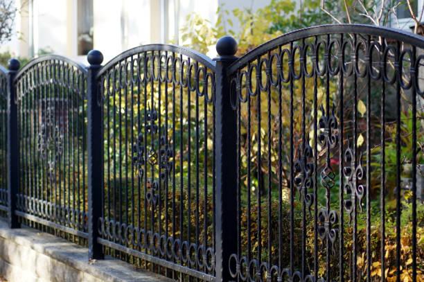 iron garden fence for protection and safety - staccionata foto e immagini stock