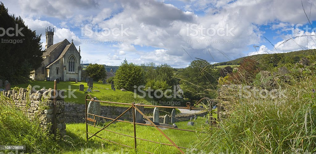 Iron Gate and Church in Countryside royalty-free stock photo