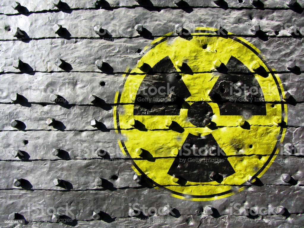 Iron Gate Background with radiation symbol Sign for Radioactivity on a cast iron texture Backgrounds Stock Photo