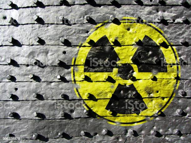 Iron Gate Background With Radiation Symbol Stock Photo - Download Image Now
