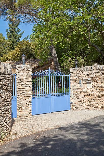 Iron Gate in Stone Wall. stock photo