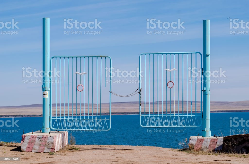 iron gate to the pond, closed with a chain - Royalty-free Abstract Stock Photo