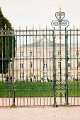Iron gates to Paris' Jardin du Luxembourg with the French Senate in the background.