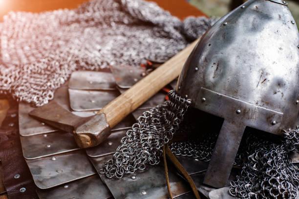 Iron helmet in armor and ax stock photo