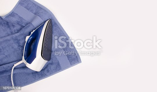 istock Iron in hand towel close up macro on a white background 1070101328