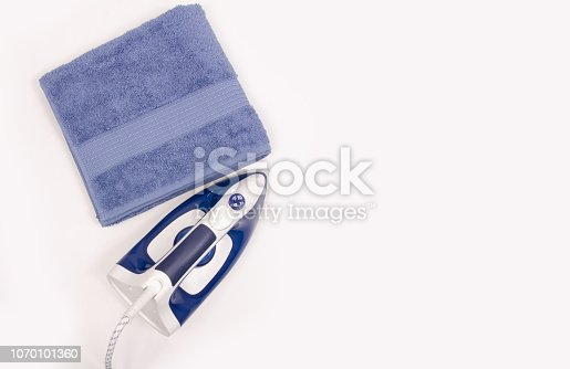 istock Iron in hand towel close up macro on a white background 1070101360