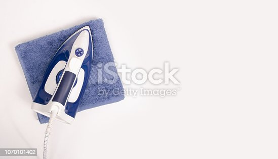 istock Iron in hand towel close up macro on a white background 1070101402