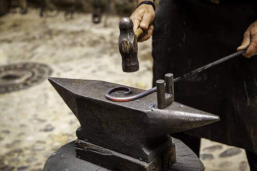 547224670 istock photo Iron incandescent in an old metal forge 1134120966