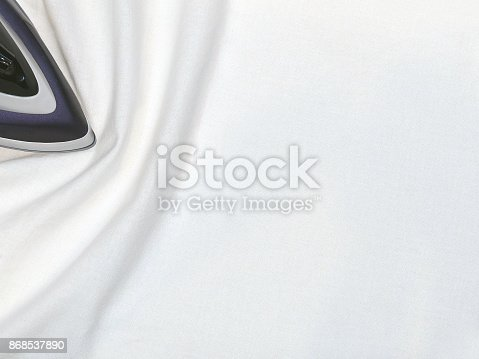 868537890 istock photo Iron, ironing white linen 868537890