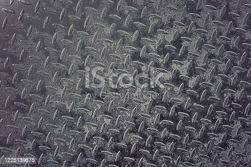 iron metal wall surface showing emboss pattern close up photo