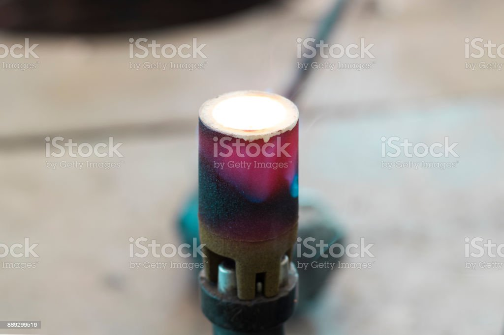 iron molten cooling down in CE Cup stock photo