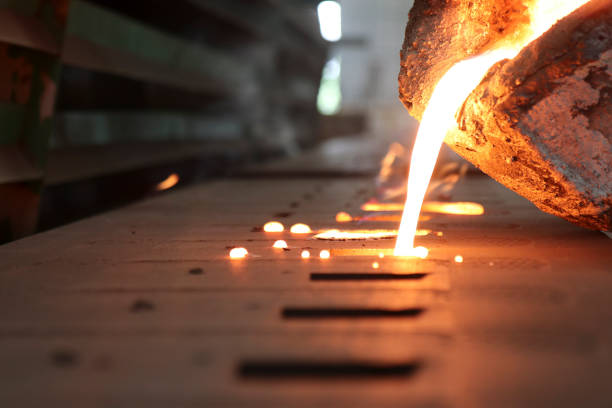 Iron molten metal pouring in sand mold Iron molten metal pouring in sand mold ; green sand process casting stock pictures, royalty-free photos & images