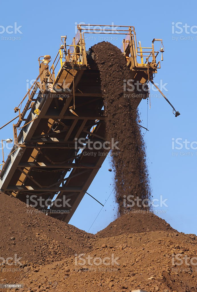 Iron ore being loaded onto a stockpile. royalty-free stock photo