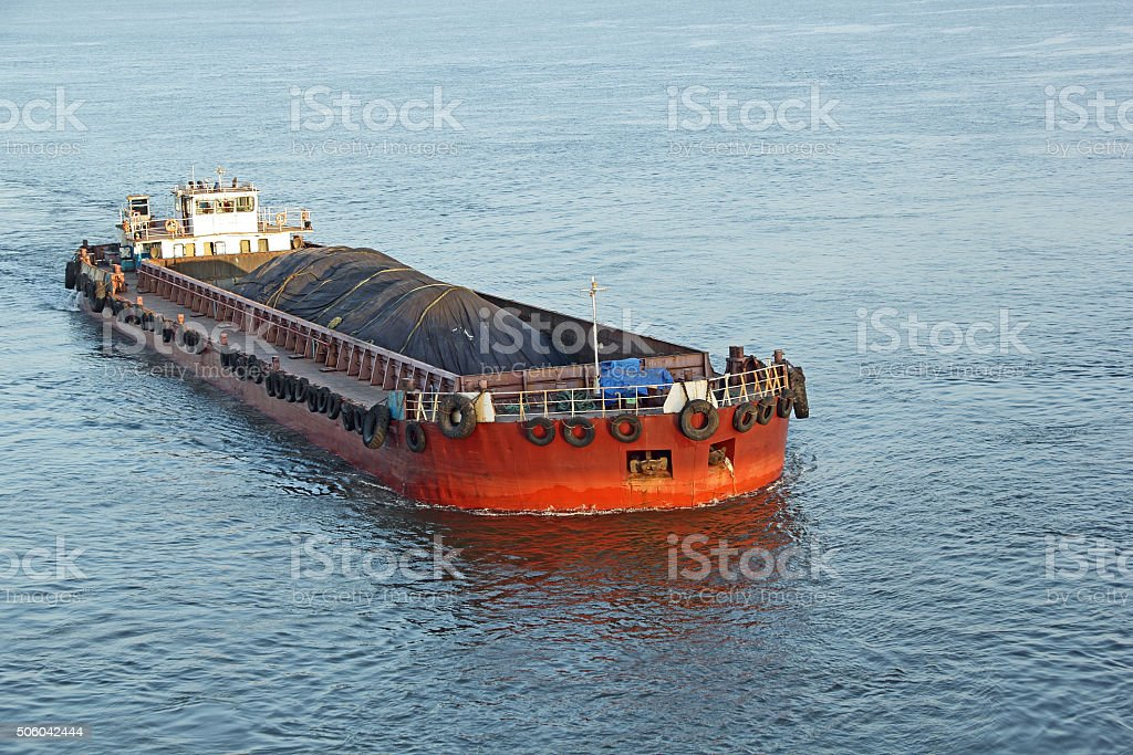 Iron Ore Carrying Cargo Barge stock photo