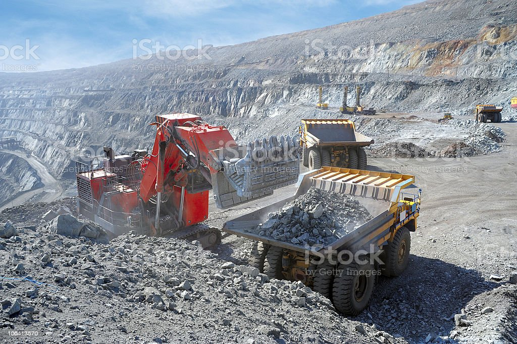 Iron ore loaded into a machine stock photo