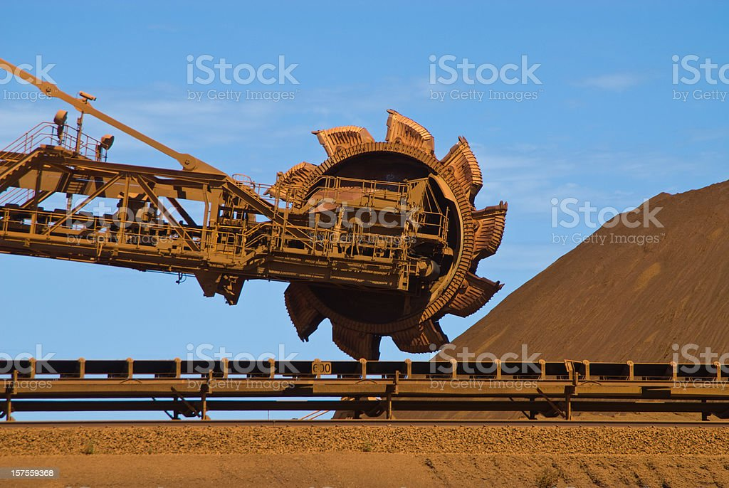 Iron ore mine site with reclaimer running  stock photo