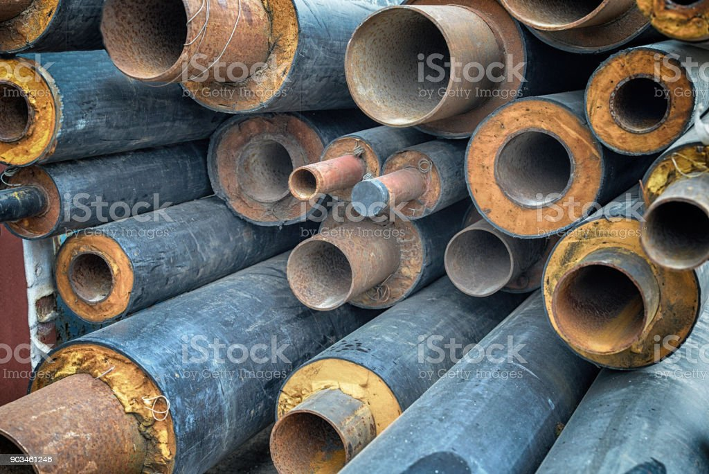 Iron metal pipes with insulation for hot water.