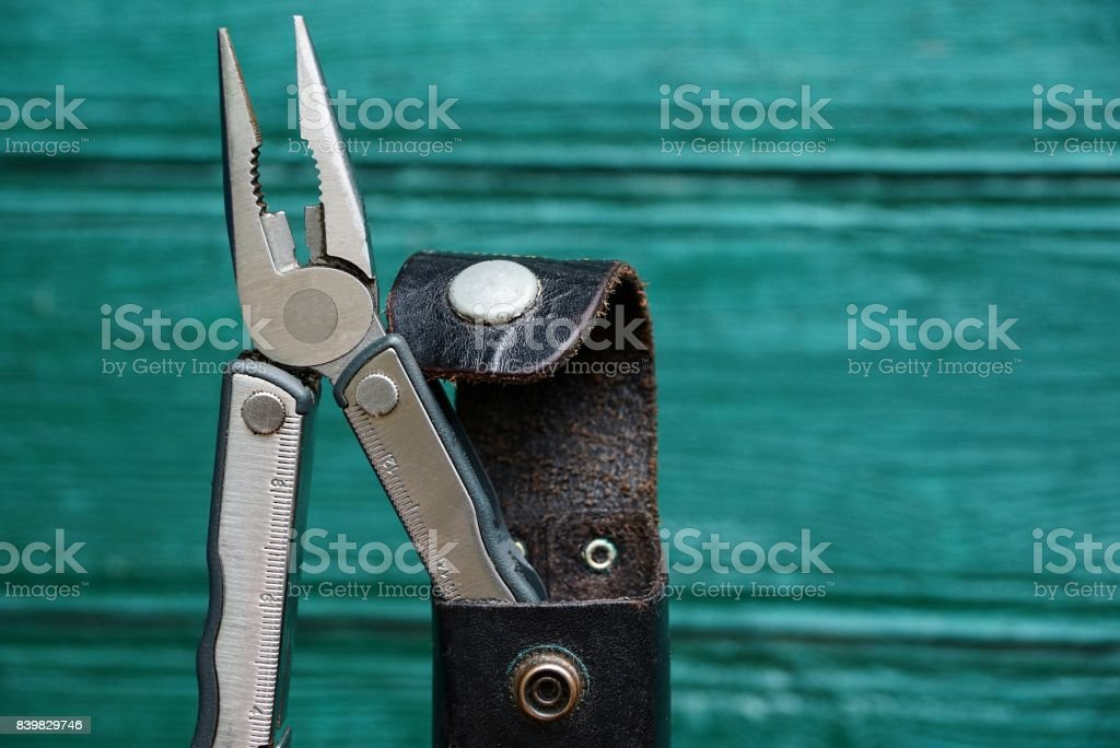 iron pliers in leather case stock photo