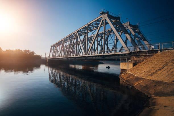 Iron railway bridge over Voronezh river Iron railway bridge over Voronezh river. railway bridge stock pictures, royalty-free photos & images