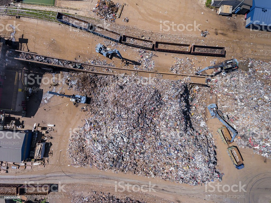 Iron raw materials recycling pile, work machines. royalty-free stock photo