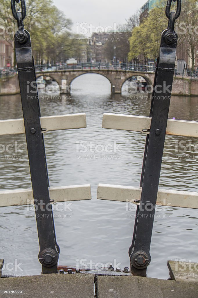 Iron Straps on Amsterdam bridge stock photo