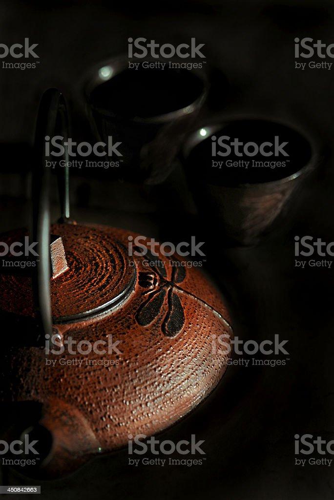 Iron teapot with teacups royalty-free stock photo