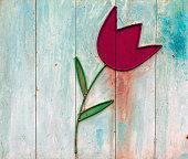 iron tulip flower on a textured background.
