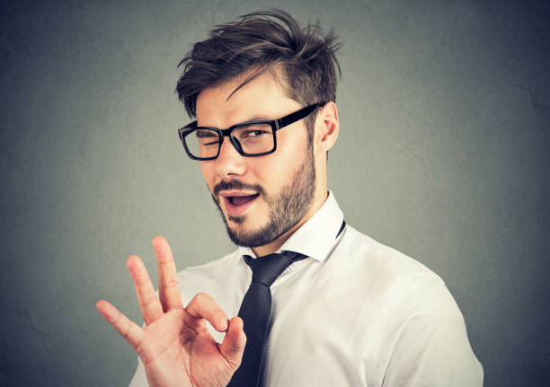 ironic man showing ok gesture - blinking stock pictures, royalty-free photos & images