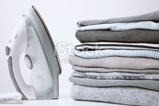 istock Ironing clothes on ironing board 1125962173