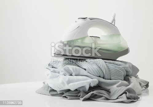 istock Ironing clothes on ironing board 1125962733