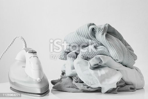 istock Ironing clothes on ironing board 1125963271