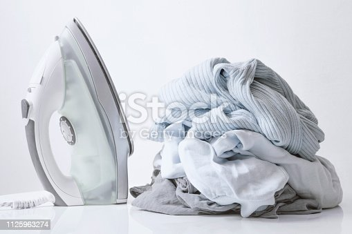 istock Ironing clothes on ironing board 1125963274
