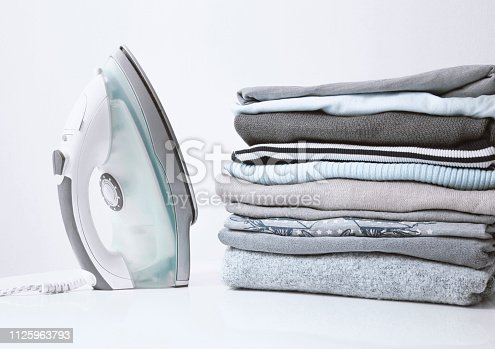 istock Ironing clothes on ironing board 1125963793