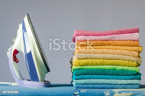 901620964 istock photo Ironing colorful towels 467948488