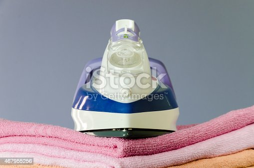 901620964 istock photo Ironing colorful towels 467955256
