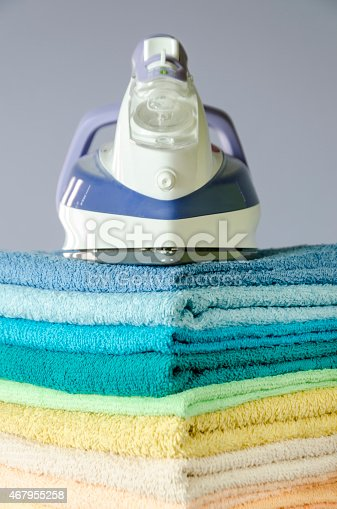 901620964 istock photo Ironing colorful towels 467955258