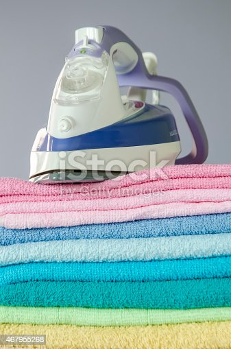 901620964 istock photo Ironing colorful towels 467955268