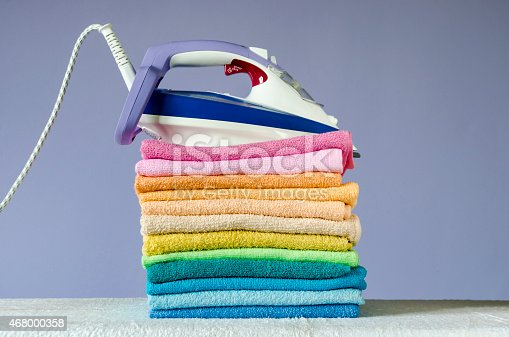 901620964 istock photo Ironing colorful towels 468000358