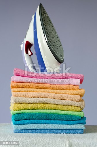 901620964 istock photo Ironing colorful towels 468000360