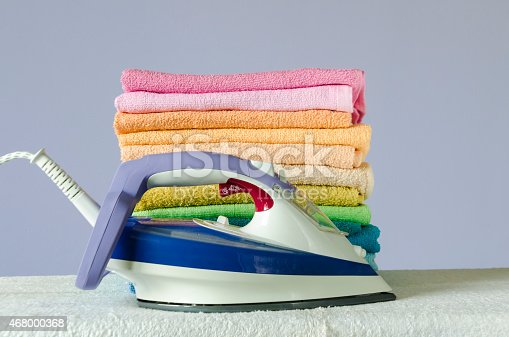 901620964 istock photo Ironing colorful towels 468000368
