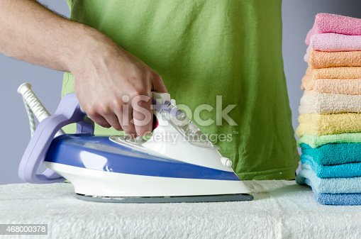 901620964 istock photo Ironing colorful towels 468000378