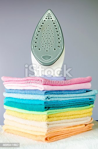 901620964 istock photo Ironing colorful towels 468941862