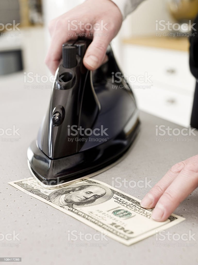 Ironing money stock photo