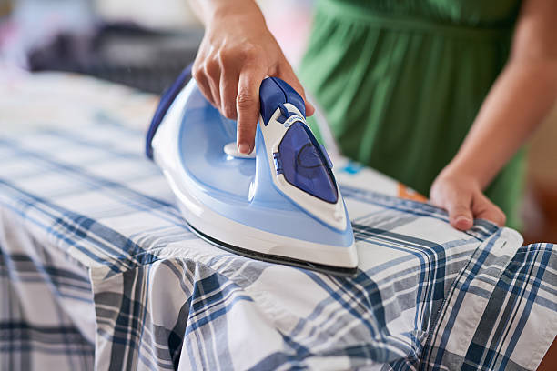 ironing out the wrinkles - ironing stock photos and pictures