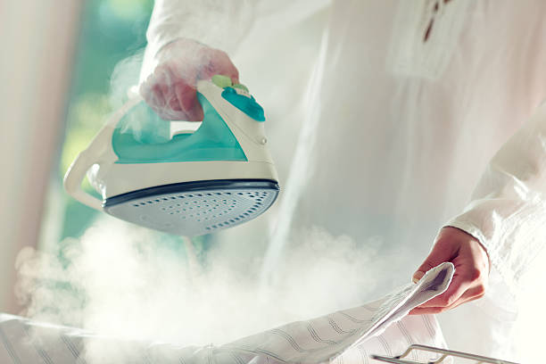 ironing - ironing stock photos and pictures