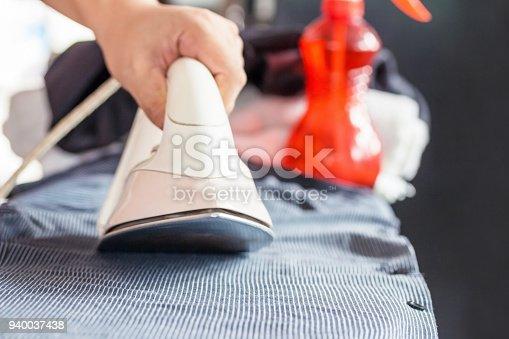 901620964 istock photo Ironing with iron,Bored home work 940037438